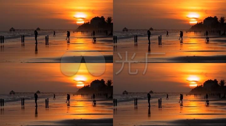 夕阳下海边人影日出日落下的海边人影