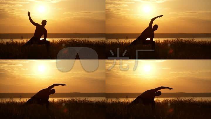 做瑜伽唯美夕陽逆光剪影圖片