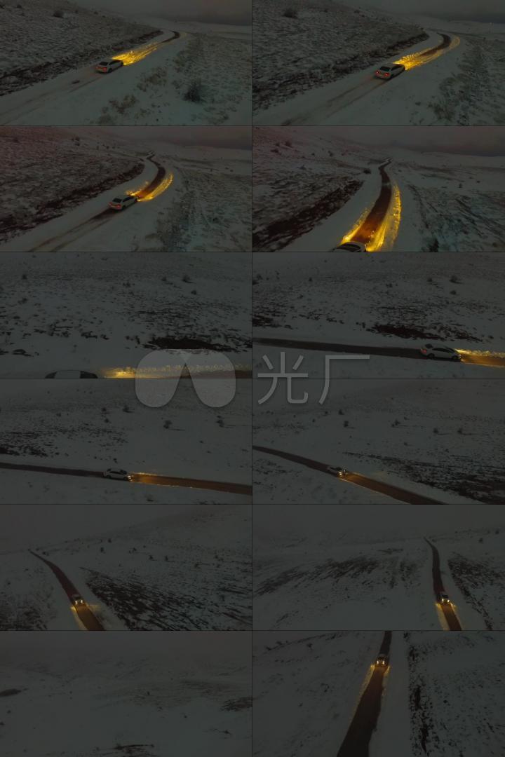 雪夜山间公路行使的汽车
