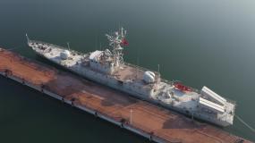航拍退役废弃靠港军舰视频素材