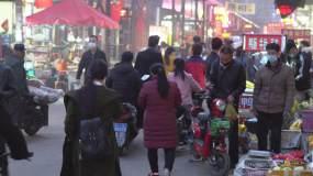 肺炎疫情籠罩下的城中村商販人流小吃攤視頻素材