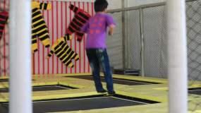 儿童蹦床积木旋转木马招手玩耍视频素材