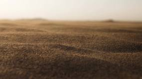 【4K】沙漠砂砾细沙飞扬闪耀发光视频素材