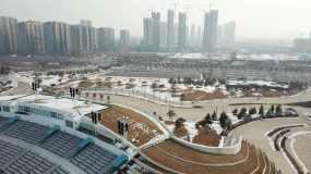 航拍太原晋阳湖剧场晋阳里雪景4K视频素材