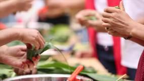 4k小区组织包粽子比赛端午节视频素材