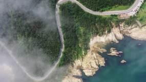 4K威海环海路风光/海岸礁石/云雾/别墅视频素材
