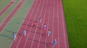 云南曲靖体育中心城市航拍跑步训练视频素材