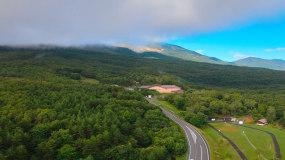 4k航拍森林公路高空云层视频素材