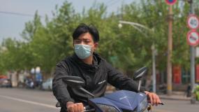 电动车骑车骑电动车道路航拍视频素材