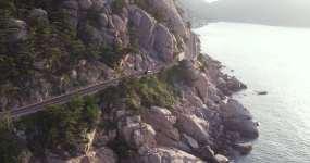 青岛崂山景区海岸线公路汽车跟拍视频素材