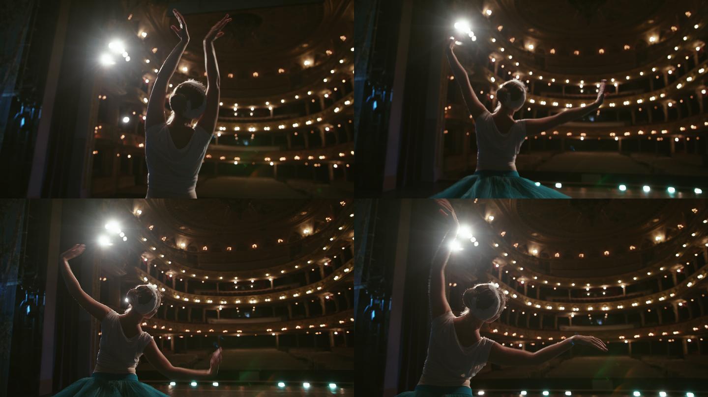 在剧院舞台上的表演的芭蕾舞演员