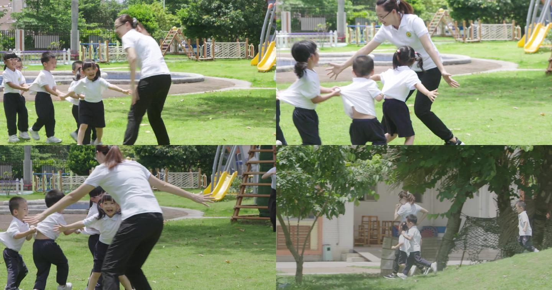 幼儿园老师与小朋友户外玩耍